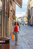 Mature woman shopping. Walking the streets of Italian city Royalty Free Stock Image