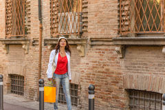Mature woman shopping. Walking the streets of Italian city Royalty Free Stock Photography