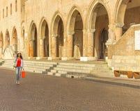 Mature woman shopping. Walking the streets of Italian city Stock Photo