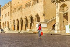 Mature woman shopping. Walking the streets of Italian city Royalty Free Stock Images