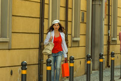 Mature woman shopping. Walking the streets of Italian city Stock Photography