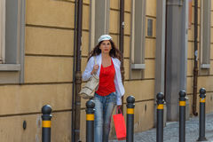 Mature woman shopping. Walking the streets of Italian city Royalty Free Stock Photos