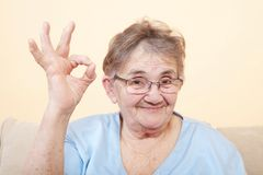 Mature woman show okay sign Royalty Free Stock Photo