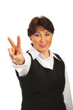 Mature woman show victory sign hand Stock Photos