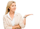 Mature woman showing empty copy space isoated on white backgroun Royalty Free Stock Photography