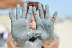 Mature woman showing healthy mineral blue mud on p Stock Image