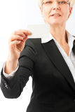 Mature woman showing her business card Royalty Free Stock Photography