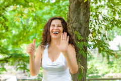 Mature woman showing number six Stock Image