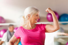 Mature woman showing off her bicep Royalty Free Stock Photography