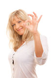 Mature woman showing ok sign hand gesture isolated. Business, gesture and office concept. Happy mature woman showing ok sign isolated Stock Photography