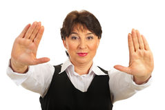 Mature woman showing palms Stock Photos