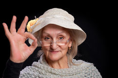 Mature woman showing sign ok Royalty Free Stock Image