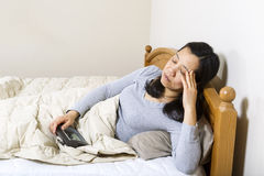 Mature woman showing stress from not sleeping Stock Photography
