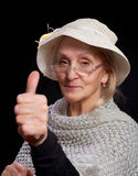 Mature woman showing thumb up Stock Images