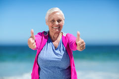 Mature woman showing thumbs up Stock Photography