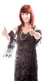 Mature woman showing thumbs up sign from both hands Royalty Free Stock Photography
