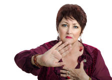 Mature woman shows gesture back off Royalty Free Stock Image