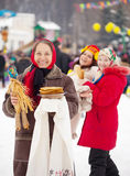 Mature woman during  Shrovetide. Mature women with pancake during  Shrovetide at Russia Stock Photo