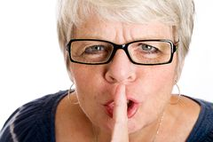 Mature woman shushing. Royalty Free Stock Photos