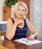 Mature woman signing documents Royalty Free Stock Photography
