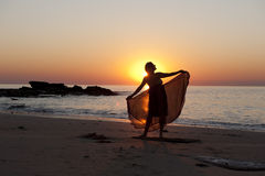 Mature Woman Silhouette at Beach Stock Photo