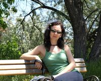 Mature woman sitting in city park Royalty Free Stock Photo