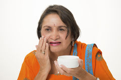 Mature woman skincare Stock Photos
