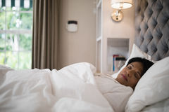 Mature woman sleeping on bed at home Royalty Free Stock Images
