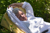 Mature woman sleeping on lounger Royalty Free Stock Images