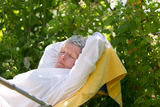 Mature woman sleeping on lounger Royalty Free Stock Photos