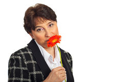 Mature woman smelling gerber Royalty Free Stock Images