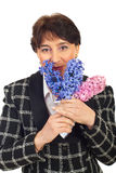Mature woman smelling hyacinth Stock Photos