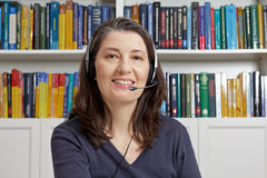 Mature woman smile headphones books Royalty Free Stock Photography