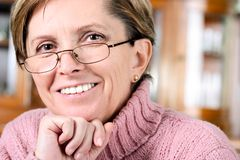 Mature woman smiles royalty free stock photography