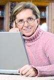 Mature woman smiling Stock Photos