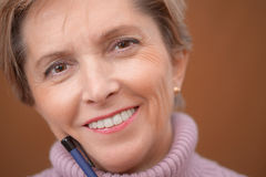 Mature woman smiling Royalty Free Stock Photos