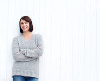 Mature woman smiling against white wall Royalty Free Stock Image