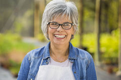 Mature woman smiling Stock Photography