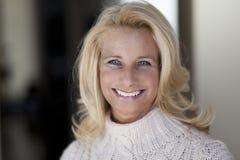 Mature woman smiling at the camera Stock Image