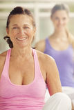 Mature woman smiling in gym class. Women in gym class smiling Stock Photography