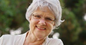 Mature woman smiling and looking at camera Royalty Free Stock Photo