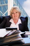 Mature woman smiling office Stock Photography