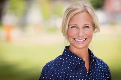 Mature woman smiling. Outside Royalty Free Stock Photo