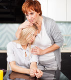Mature woman soothes sad daughter Royalty Free Stock Image