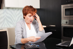 Mature woman sorting through her old receipts Stock Photos