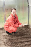 Mature woman  sows seeds Royalty Free Stock Photos