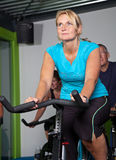 Mature woman in spinning class stock photos