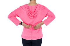Mature woman in sportswear massaging back Royalty Free Stock Images