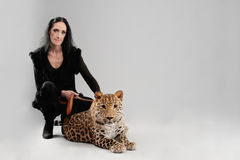 Mature woman and spotty leopard Stock Image
