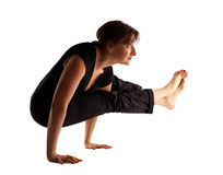Mature woman stand on hands  in yoga pose Stock Photography